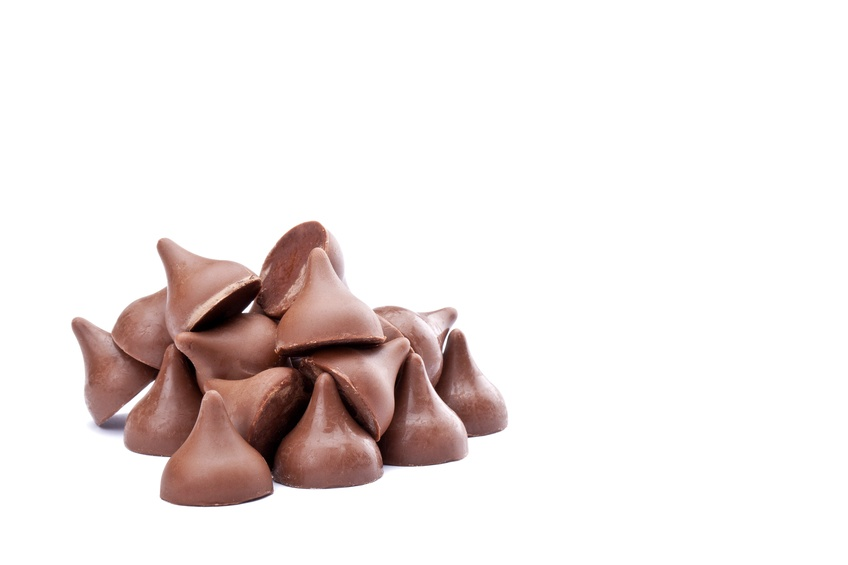 bunch of chocolate kisses on white background