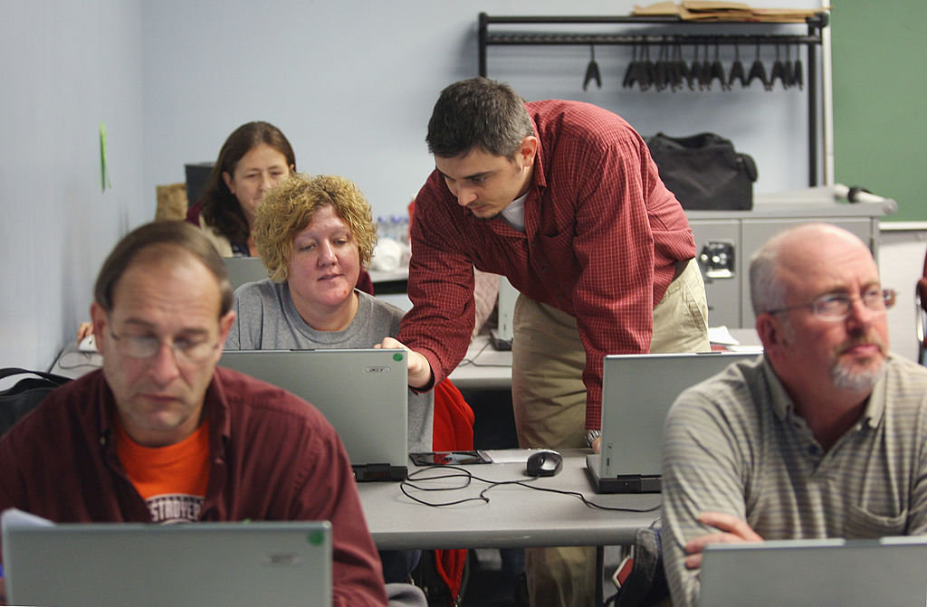 Laid-off workers attend a computer skills class