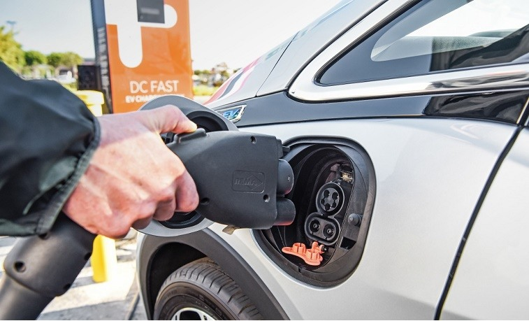 A silver 2017 Chevrolet Bolt EV stops for a charge
