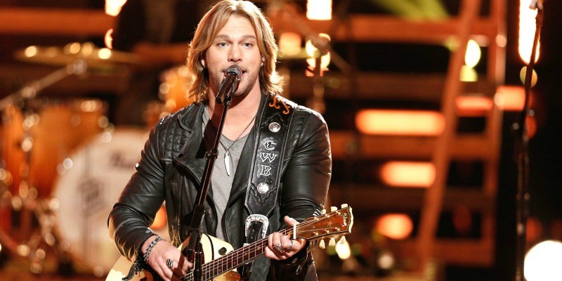 Craig Wayne Boyd performs on stage with his guitar on The Voice.