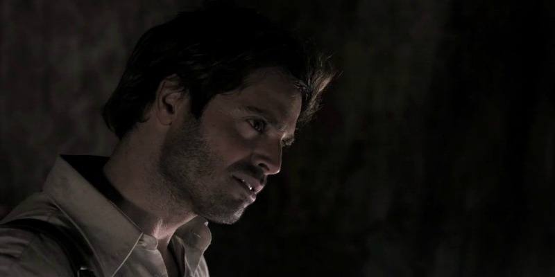 David Charvet stares to the side in Prisoners of the Sun