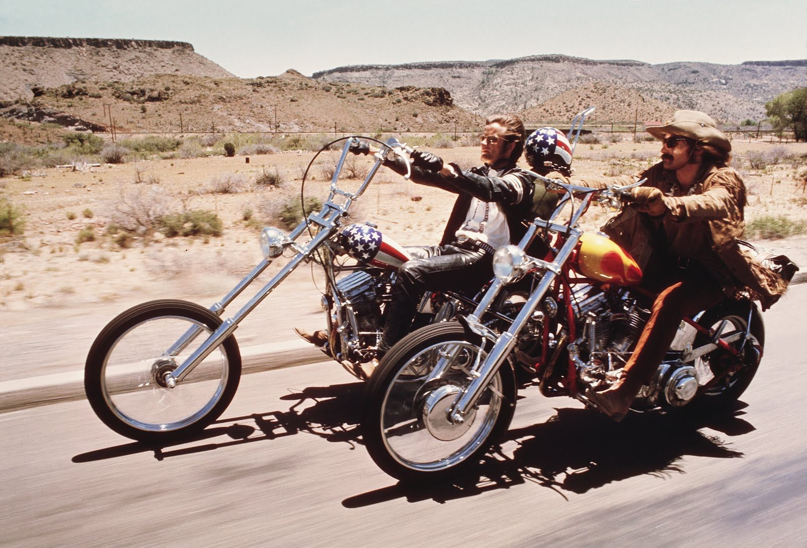 the cast of EAsy Rider on their motorcycles in the desert