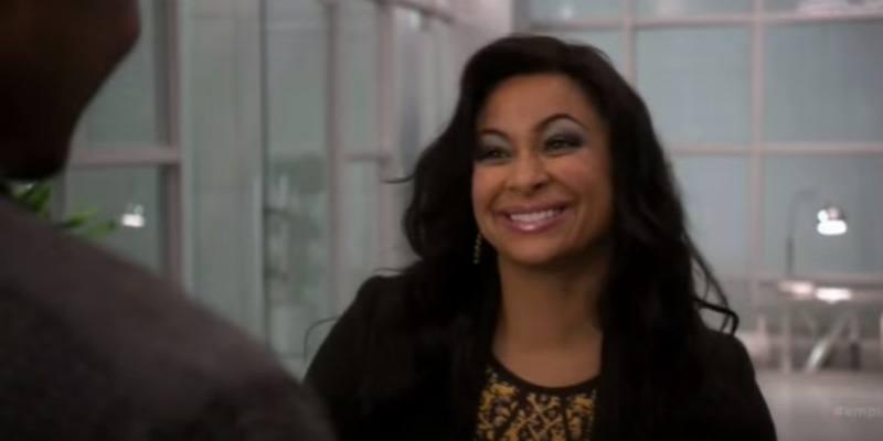 Raven Rymone smiling, wearing all black