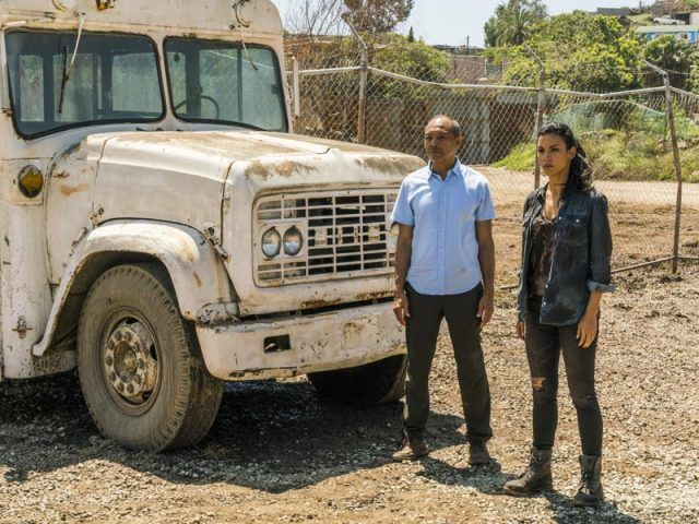 Luciana (Danay Garcia) and Alejandro (Paul Calderon) stand by a broken down bus in a scene from AMC's 'Fear the Walking Dead'