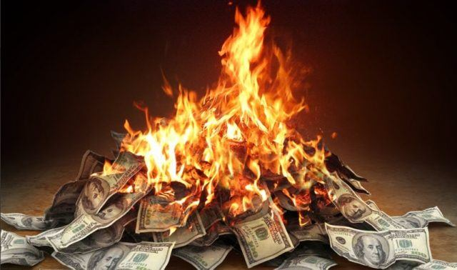 A pile of money is set on fire