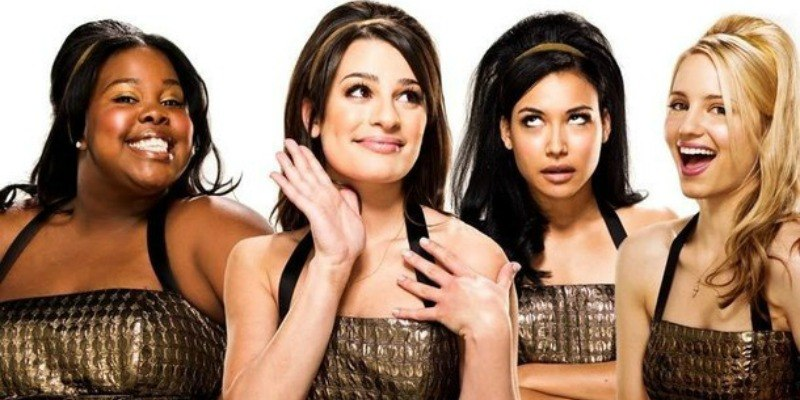 Amber Riley as Mercedes Jones, Lea Michele as Rachel Berry, Naya Rivera as Santana Lopez, and Dianna Agron as Quinn Fabray in costume on Glee