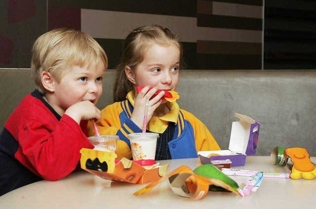 young children eating at McDonald's