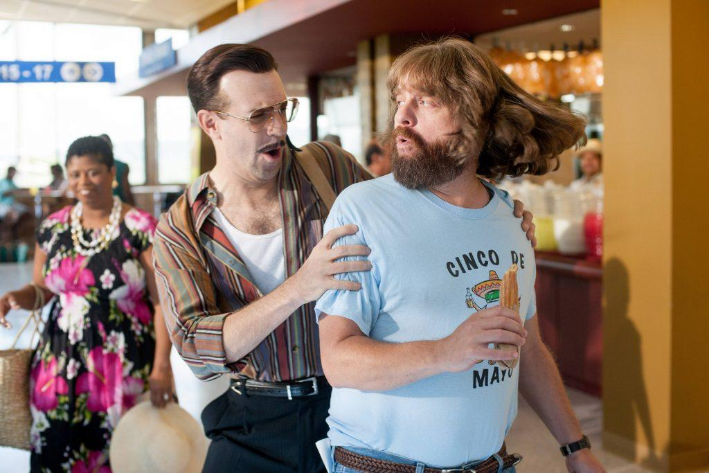 Jason Sudeikis holds onto the shoulders of Zach Galifanikis in a scene from Masterminds