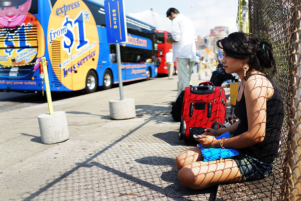 A woman waits to board a Megabus in New York City