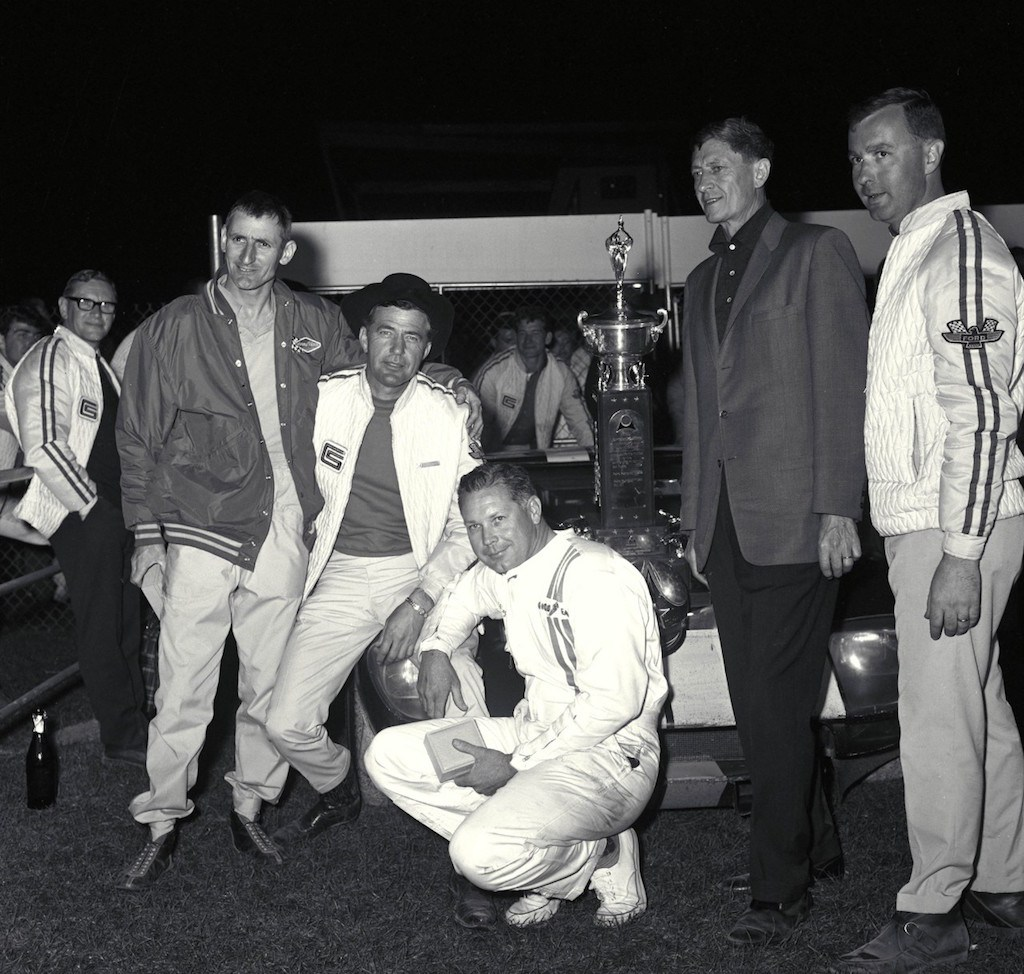 The Ford GT's first overall victory, 1965: (L to R) Ken Miles, Carroll Shelby, Lloyd Ruby, Leo Beebe, Ray Geddes.   Ford
