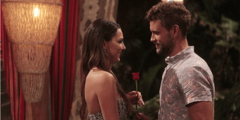 Nick Viall is giving Jen Saviano a rose.