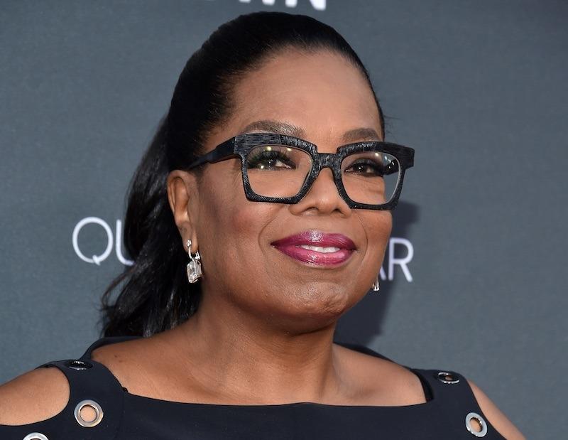 Oprah Winfrey smiling and wearing glasses