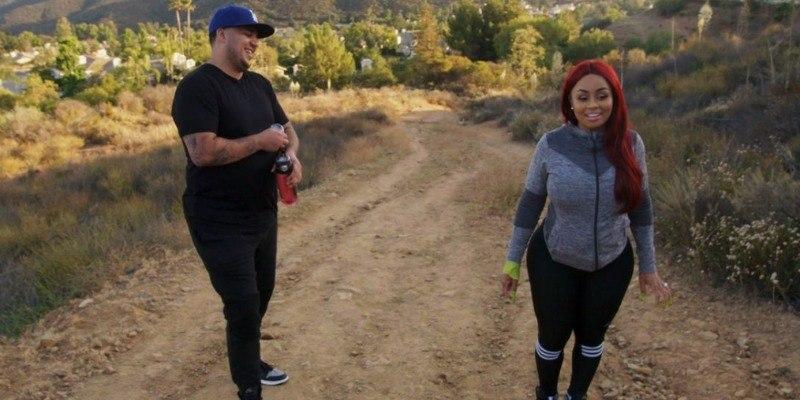 Rob Kardashian and Blac Chyna walk on a dirt road in Rob & Chyna