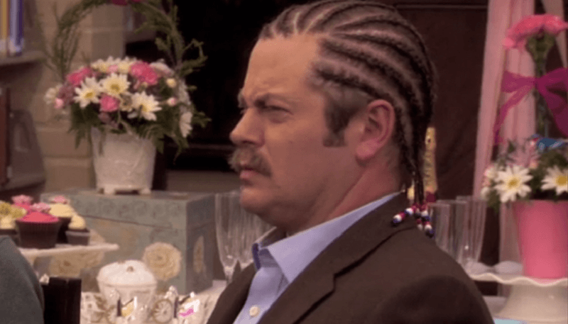 Ron Swanson, equipped with a curious hair style, looking quizzical