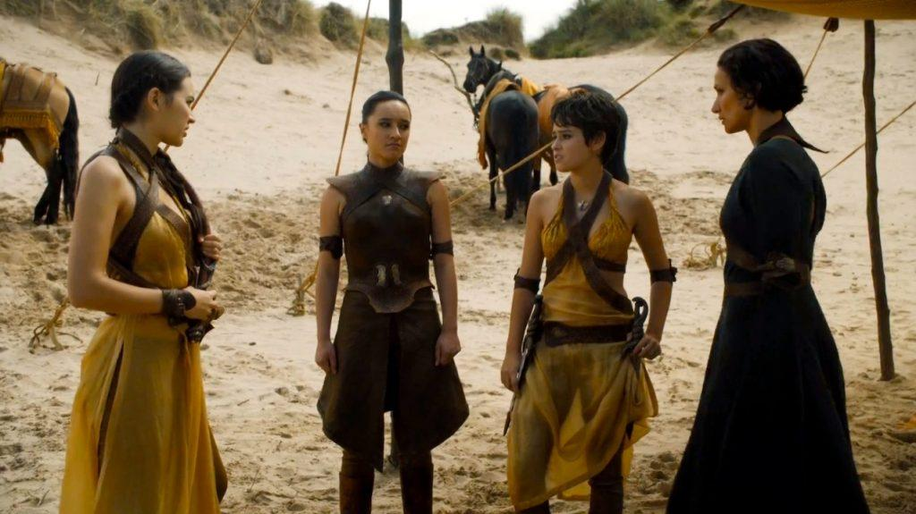 The Sand Snakes standing in a circle outside
