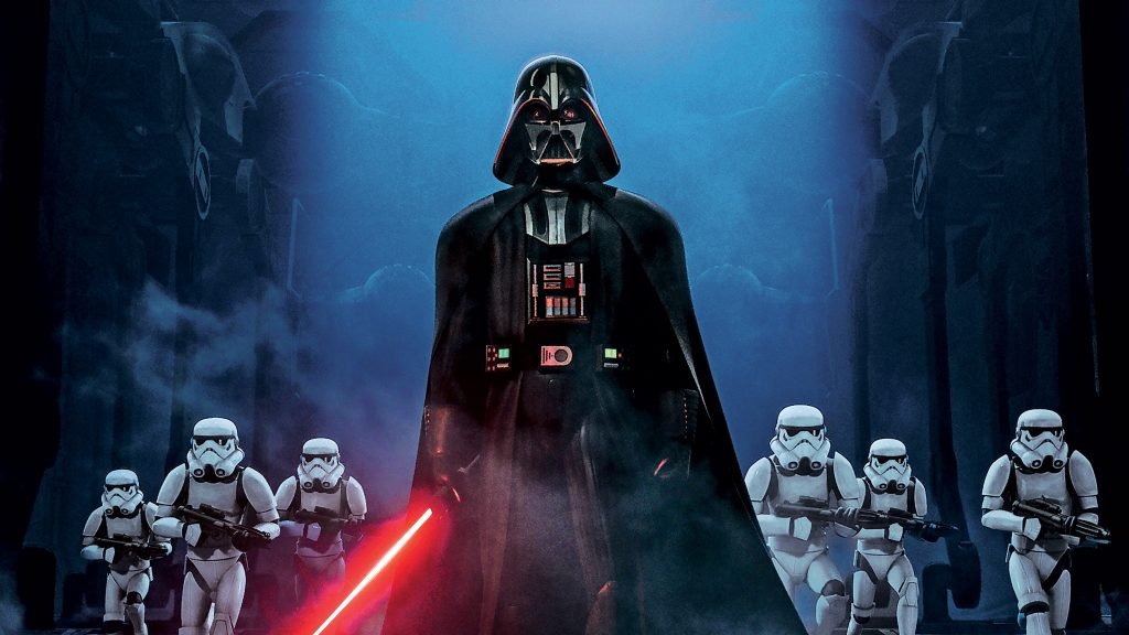 Darth Vader holds a red lightsaber as stormtroopers gather behind him on Star Wars Rebels