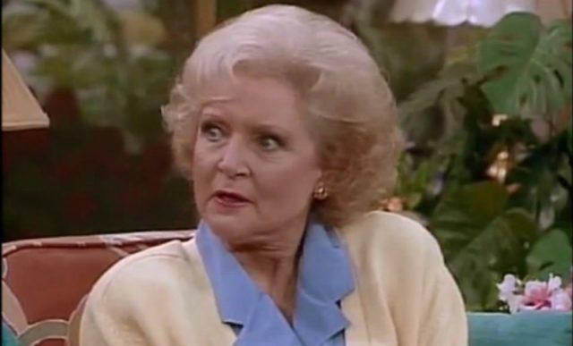 Betty White sitting a couch and talking in 'The Golden Girls'.