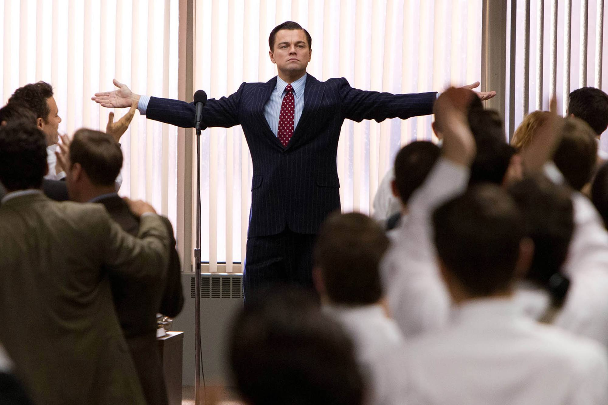 A still from 'The Wolf of Wall Street' shows loyalty and praise to the film's antihero, Jordan Belfort