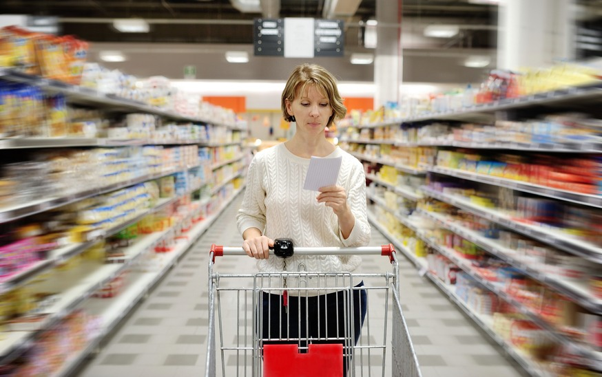 caucasian woman with shopping list