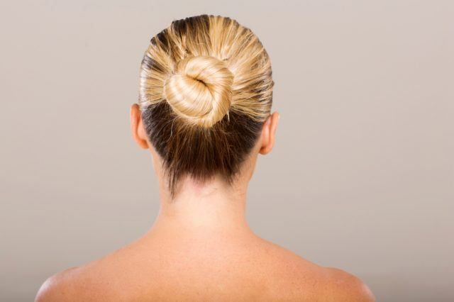 young woman with hair in a bun