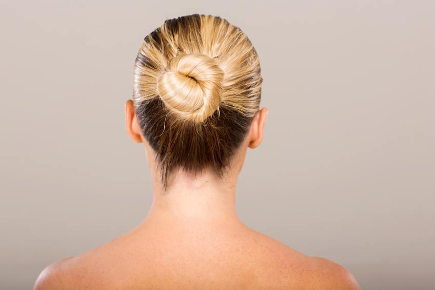 young woman with hair bun