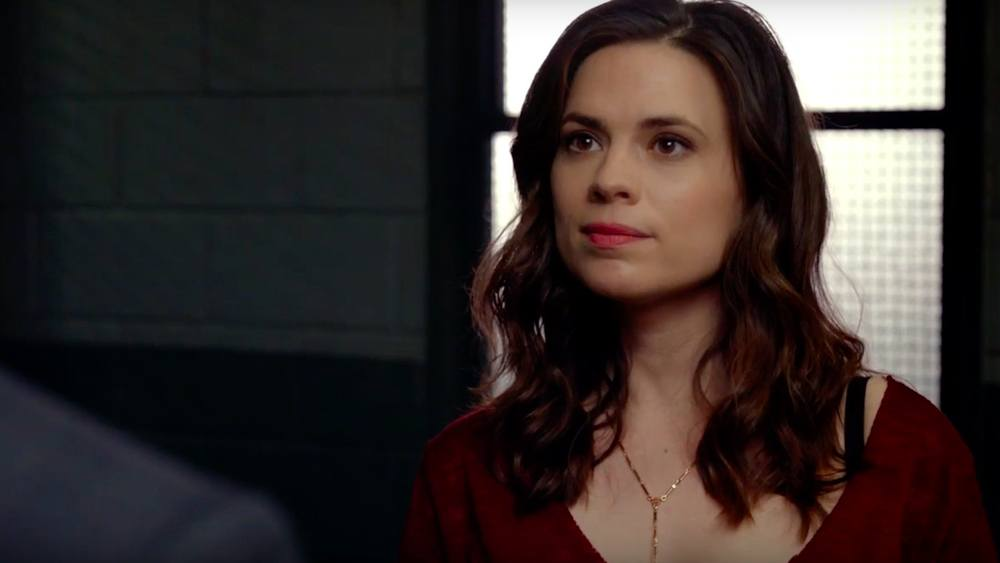 Hayley Atwell stands in front of a window in ABC's Conviction