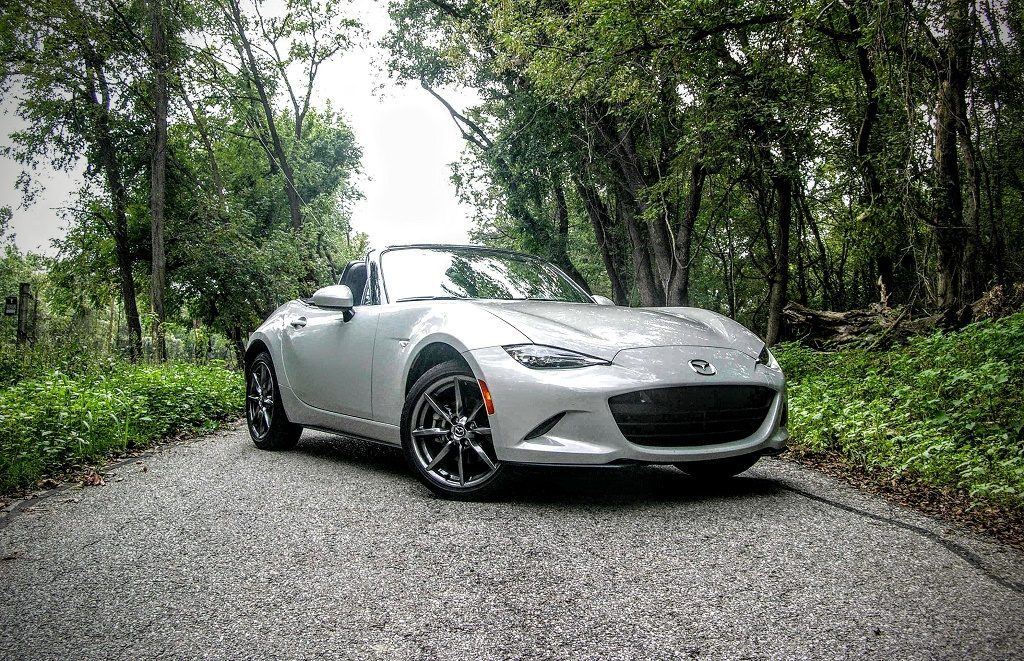 View of white Mazda Miata GT on country road