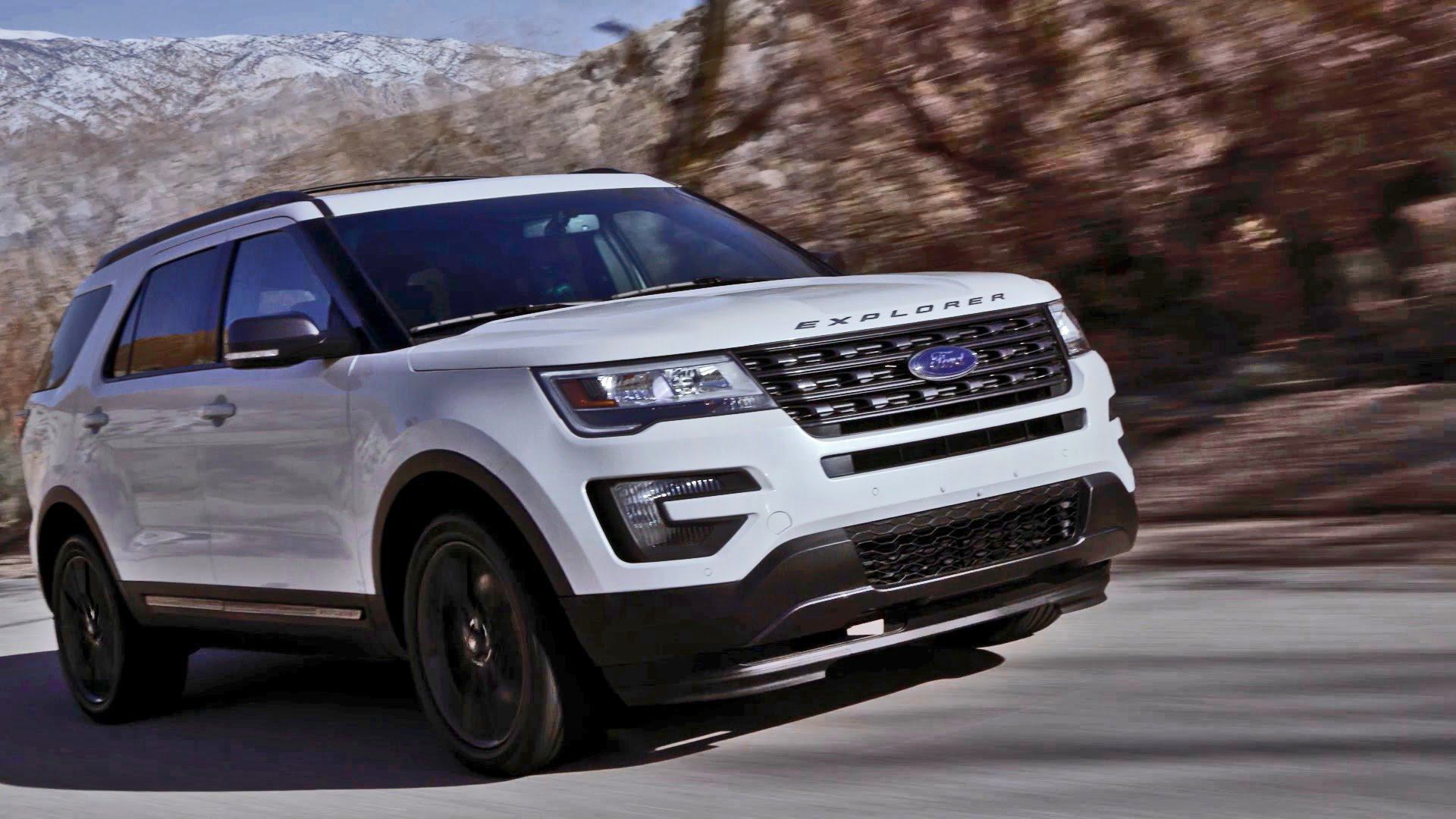 White 2017 Ford Explorer speeding down the road.