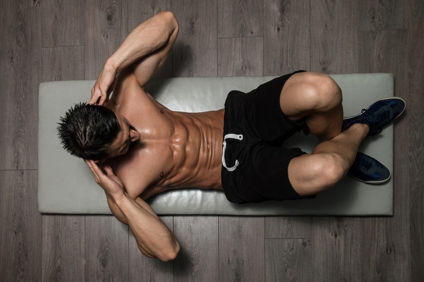 Man Exercising Abdominals