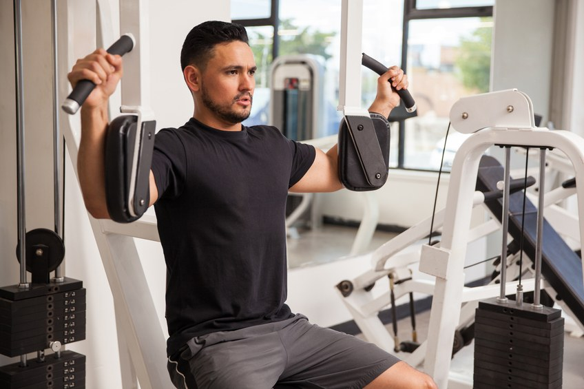 young man building muscle at the gym