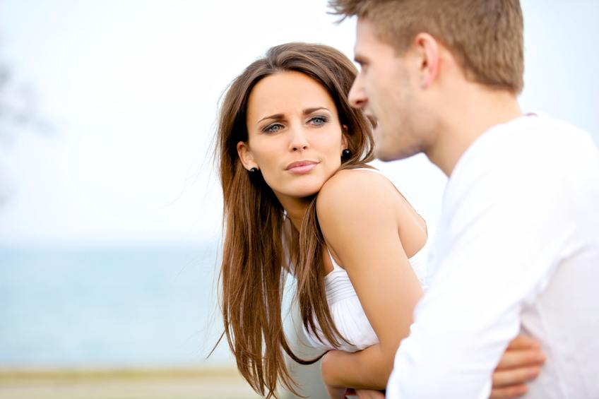 Woman seriously listening to her boyfriend