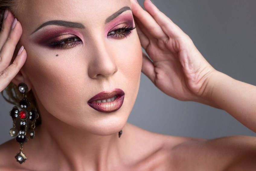 Girl with dramatic evening burgundy makeup
