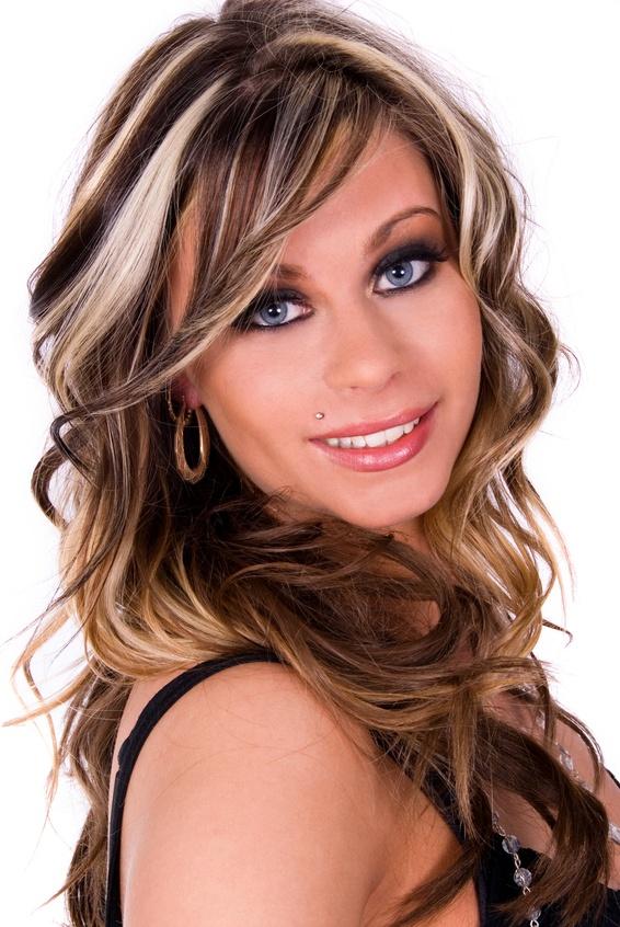beautiful woman with long wavy hair and dramatic eye make-up