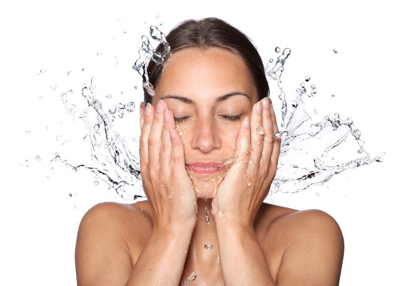wet woman face with water drop