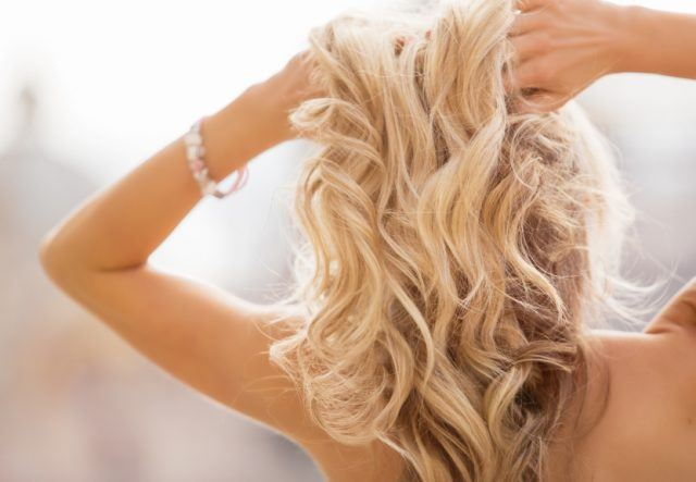 woman holding her hands in hair