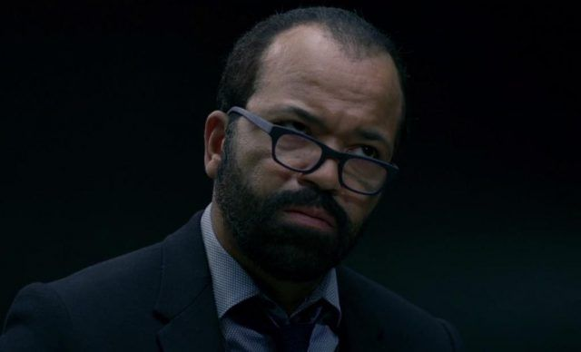 Jeffrey Wright looking confused as he looks over his glasses.