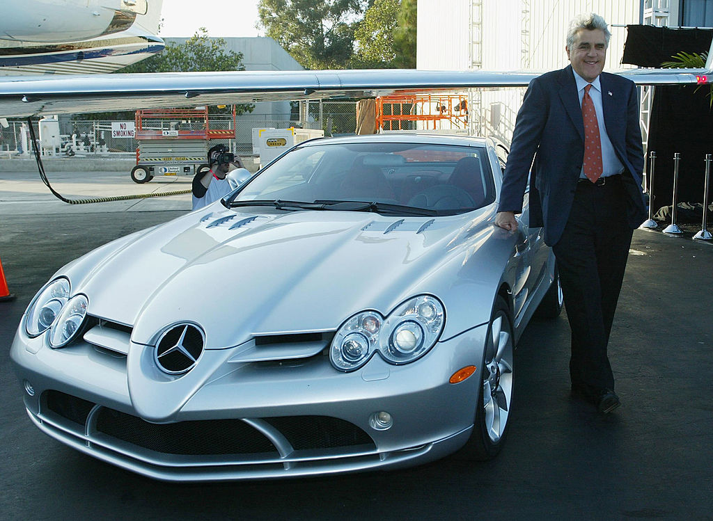 Host Jay Leno stands by his Mercedes SLR