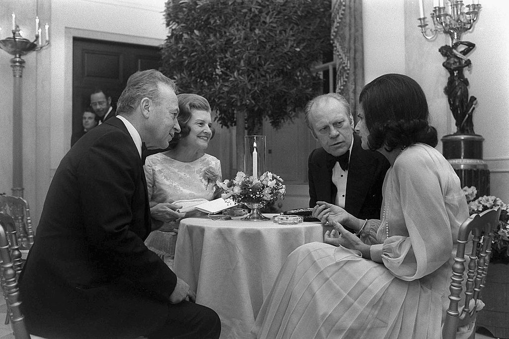 U.S. President Gerald Ford (2nd R) and his wife Betty Ford (2nd L) have dinner with Israeli Prime Minister
