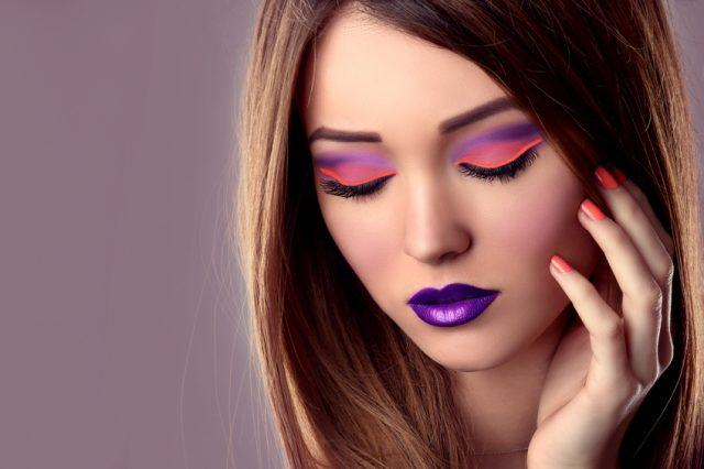 Girl with pink eyeshadow and violet lipstick