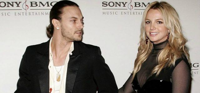Britney Spears and Kevin Federline walking together and holding hands on a red carpet.