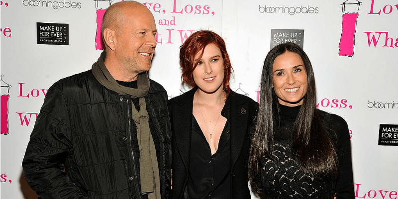 Demi Moore, Bruce and Rumer Willis and smiling and posing on the red carpet.