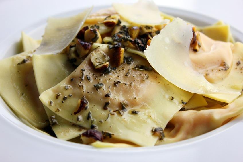 ravioli garnished with parmesan cheese