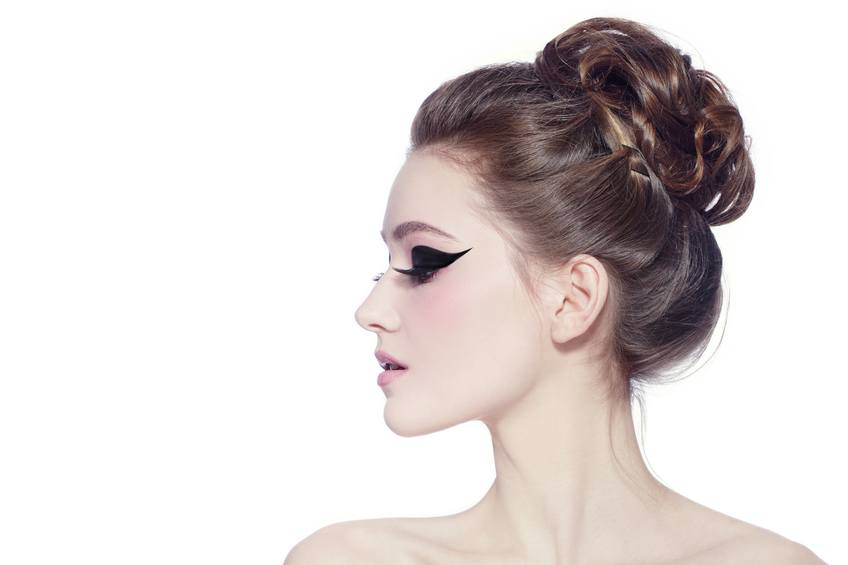 poartrait of young slim beautiful girl with hair bun