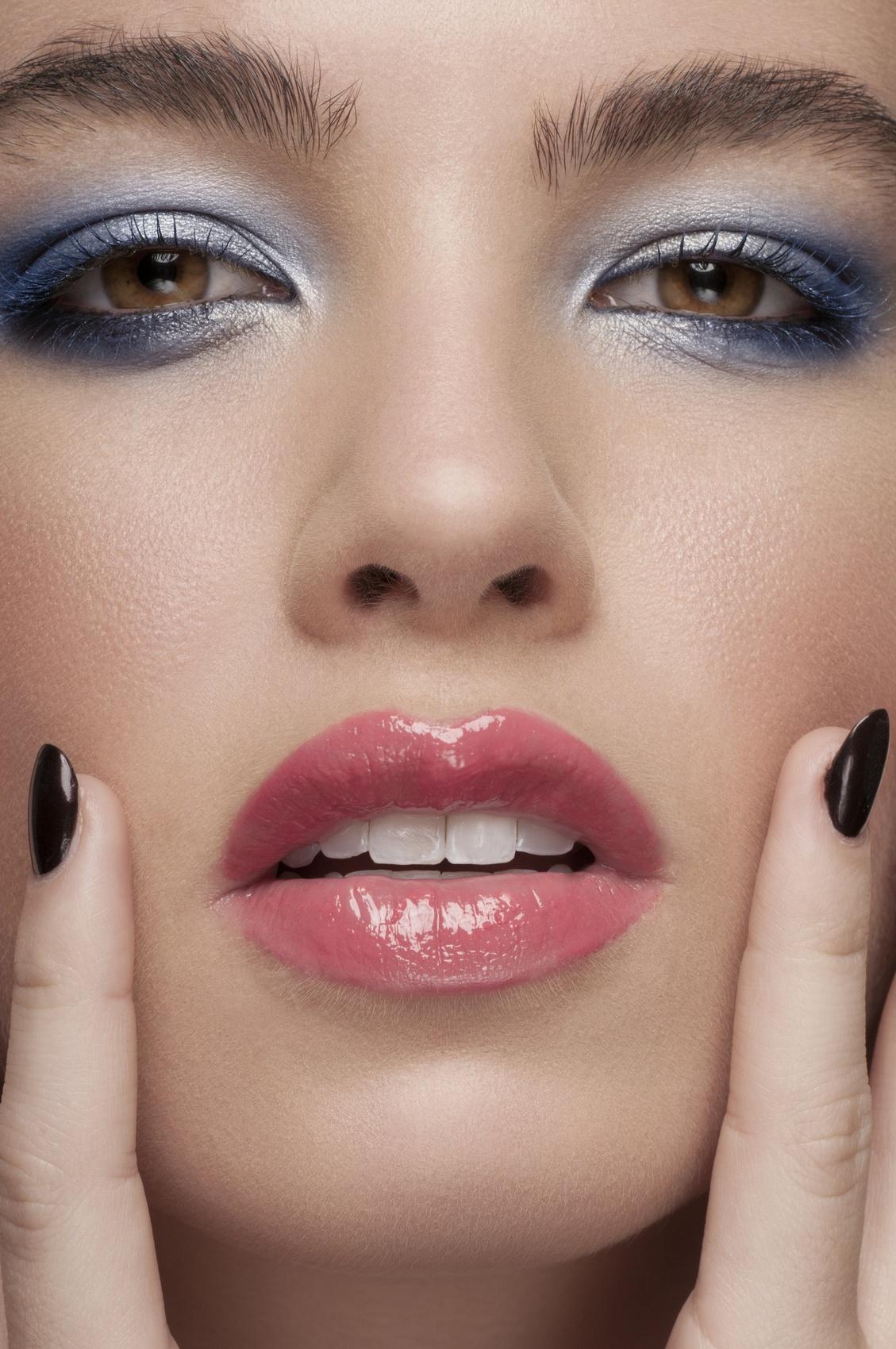 beauty close-up portrait of beautiful Caucasian woman in blue eye shadow