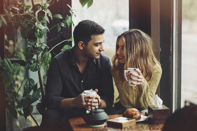 Couple in love drinking coffee together