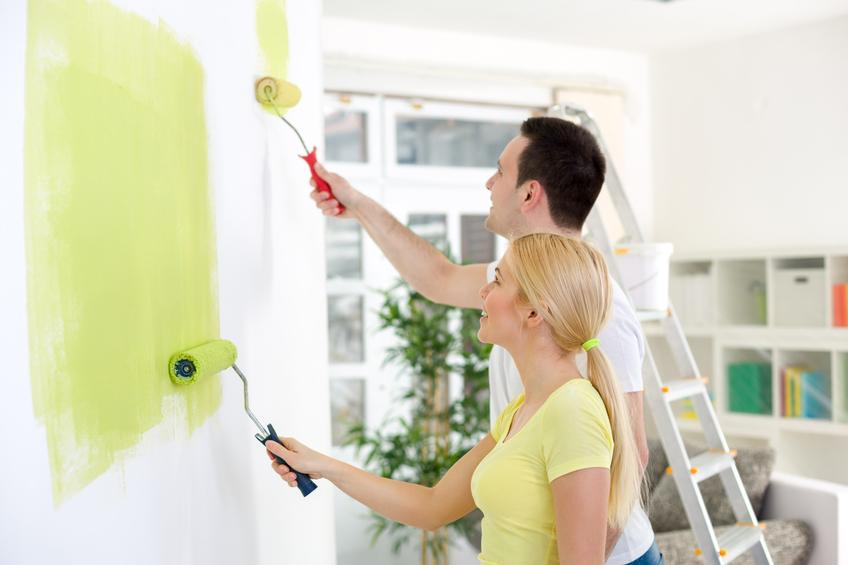 couple painting together a room in their new house