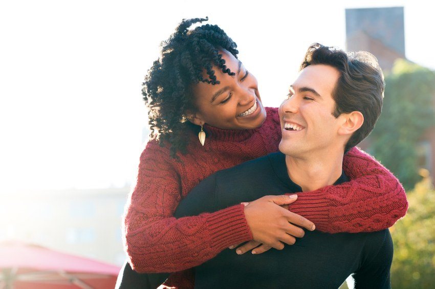 Portrait of a happy young couple enjoying outdoors