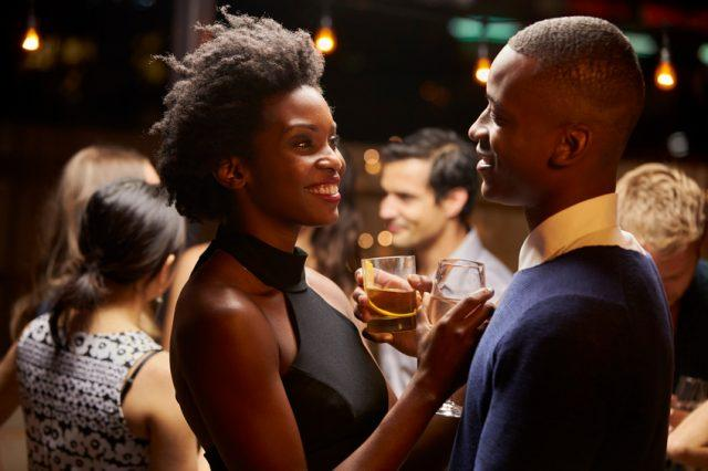 Couple smiling and having a drink