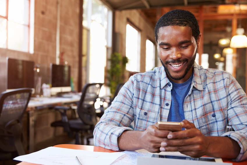 Designer Sitting At Meeting Table using social media app