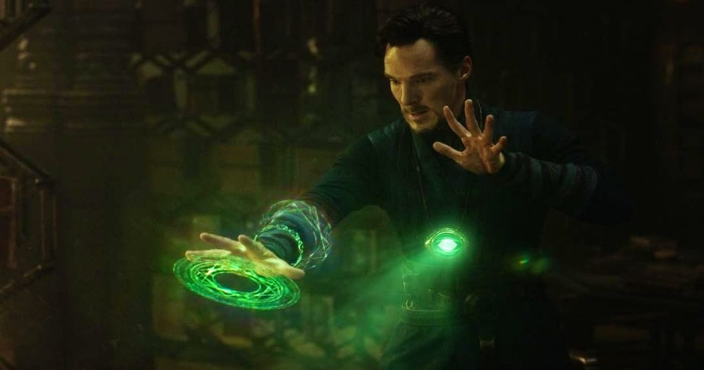 Doctor Strange with green rings around his right arm, casting a spell with the Time Stone
